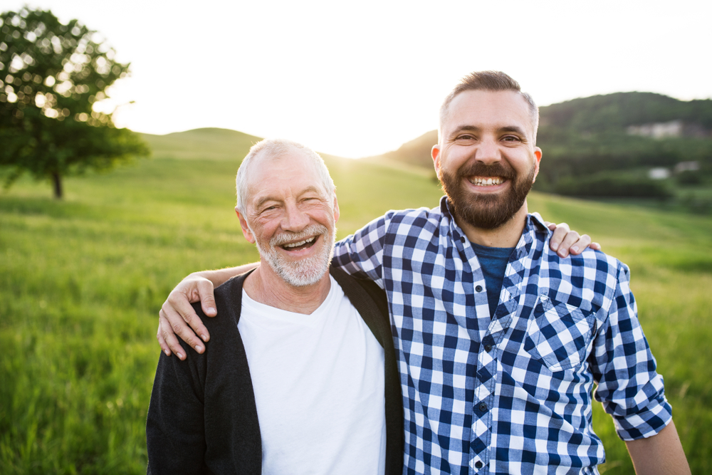 Man Spending Time With Senior Father